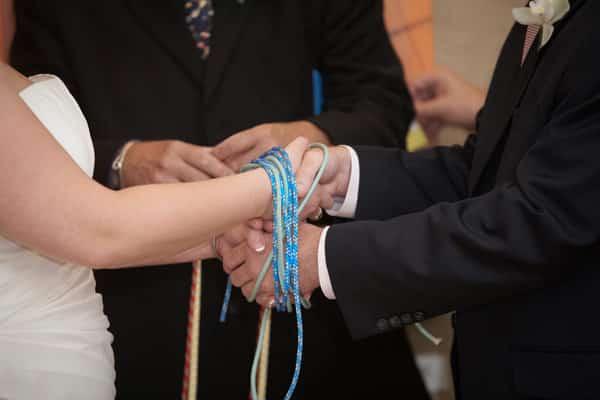 Symbolic handfasting during a wedding ceremony