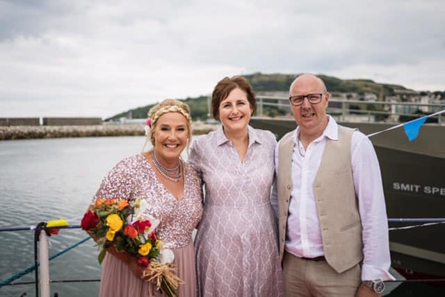Alicen Dines, Wedding Celebrant with a happy couple